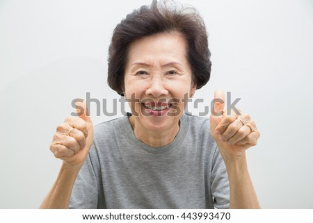 happy smiling old Woman Portrait  with Thumbs up.