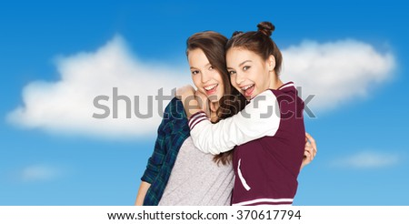 happy smiling pretty teenage girls hugging