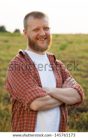 Happy smiling red-bearded man in a shirt