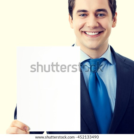 Happy smiling senior businessman showing blank signboard with blank empty copyspace area for sign or slogan text. Marketing and advertising concept. - stock photo