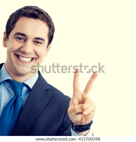 Happy smiling senior businessman showing two fingers or victory gesture. Success in business concept. - stock photo
