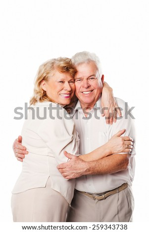 Happy smiling senior couple embracing together. Isolated on white background. - stock photo