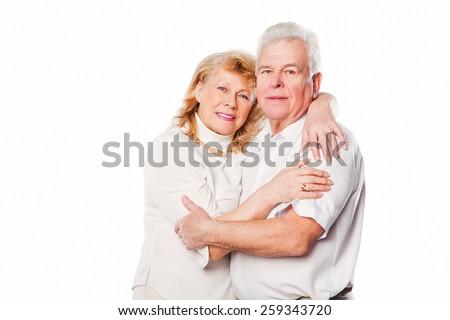 Happy smiling senior couple embracing together. On white background. - stock photo