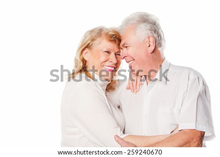 Happy smiling senior couple in love. Isolated on white background. - stock photo