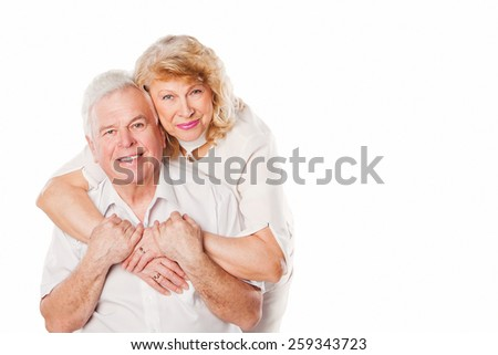 Happy smiling senior couple in love. Isolated on white background. Studio shoot
