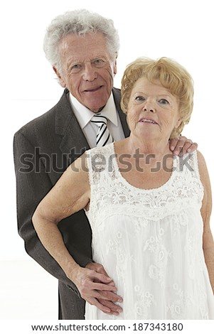 Happy smiling senior couple posing together with an embrace isolated on white background r - stock photo