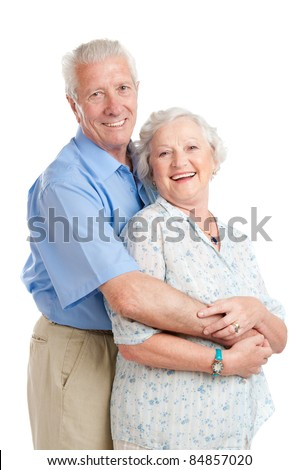 Happy smiling senior couple standing together with an embrace isolated on white background - stock photo