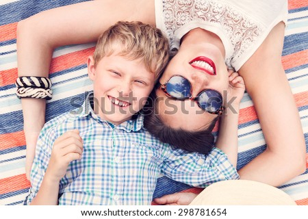 Happy smiling son with mother  - stock photo