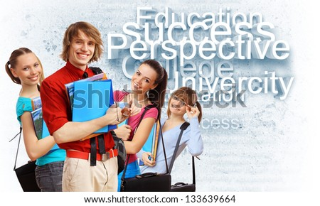 Happy smiling student standing and holding books - stock photo