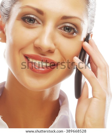Happy smiling successful businesswoman with cell phone - stock photo