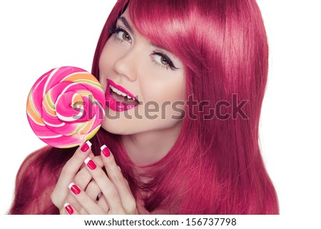 Happy smiling teen girl holding multicolored lollipop with pink long glossy hair style. Isolated on a white Background. - stock photo