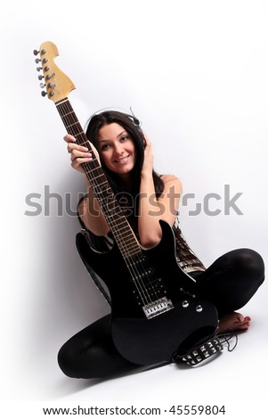 happy smiling teen playing guitar - stock photo