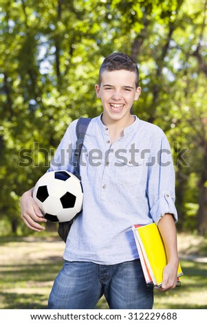 Happy smiling teenager at school park - stock photo