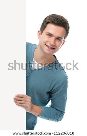 happy smiling teenager holds a blank board - stock photo