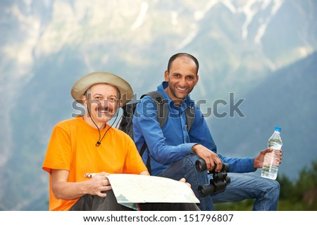 happy smiling tourist traveller hikers in india Himalayas mountains