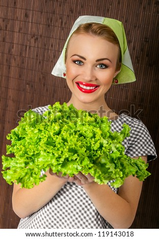 Happy smiling woman cook holding salad, close-up - stock photo