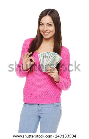 Happy smiling woman holding us dollar money and gesturing thumb up, over white background - stock photo