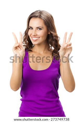Happy smiling woman in casual smart lilac clothing, showing two fingers or victory gesture, isolated against white background - stock photo