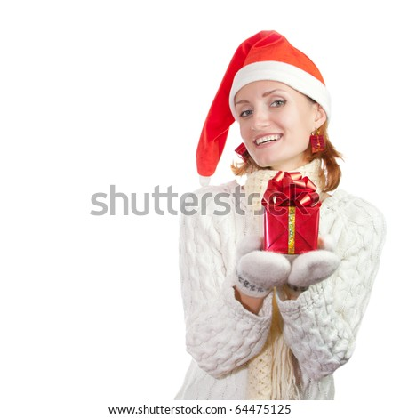 Happy smiling woman in christmas hat and mittens with gift. Isolated on white
