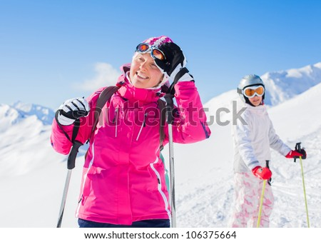 Happy smiling woman in ski goggles and with her daughter, Zellertal, Austria - stock photo