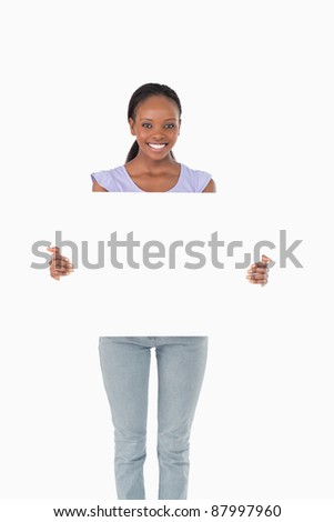Happy smiling woman presenting placeholder on white background - stock photo