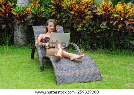 Happy smiling woman surfing internet  and enjoy the summer - stock photo