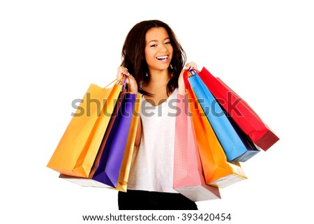Happy smiling woman with shopping bags. - stock photo