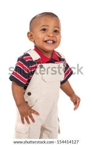 Happy Smiling 1-year old african american baby boy standing with mouth open talking