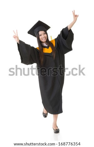Happy smiling young asian graduation woman. Full length. Isolated on white background. - stock photo