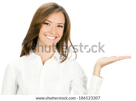 Happy smiling young beautiful business woman showing blank area for sign or copyspase, isolated over white background