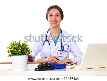 Happy smiling young beautiful female doctor showing blank area for sign or copyspace, isolated over white background - stock photo