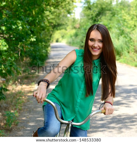 Happy smiling young beautiful woman with retro bicycle, summer outdoor - stock photo