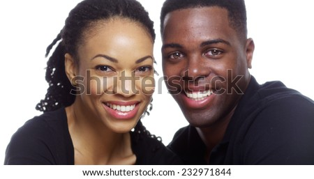Happy smiling young black couple looking at camera on white background - stock photo