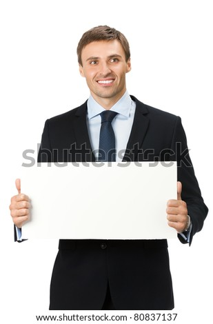 Happy smiling young business man showing blank signboard, isolated on white background