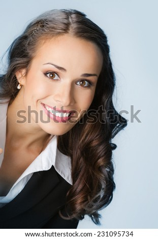 Happy smiling young business woman, over blue background - stock photo