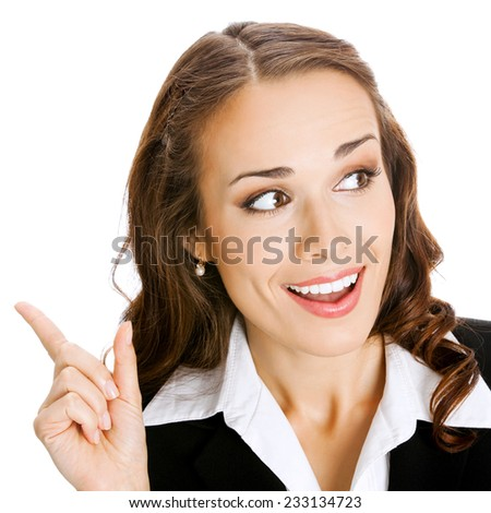 Happy smiling young business woman showing blank area for sign or copyspase, isolated against white background