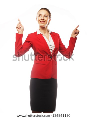 Happy smiling young business woman showing blank area for sign or copyspase, over white background
