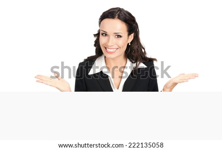 Happy smiling young business woman showing blank signboard, isolated over white background - stock photo