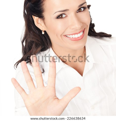 Happy smiling young business woman showing five fingers, isolated on white background - stock photo