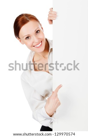 Happy smiling young business woman with a blank signboard, isolated on white background. - stock photo