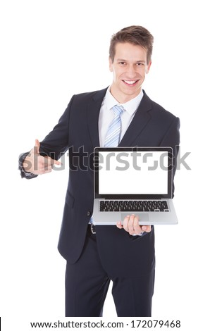 Happy Smiling Young Businessman Holding Laptop Over White Background