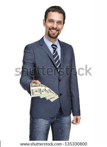 happy smiling young businessman in a suit jacket giving stack of one hundred dollar bills into the camera isolated on white background - stock photo