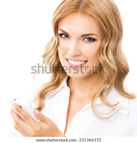 Happy smiling young businesswoman with cellphone, isolated against white background - stock photo