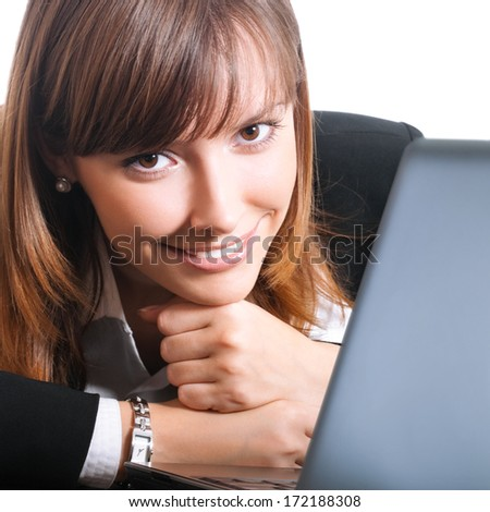 Happy smiling young businesswoman working with laptop, isolated over white background - stock photo