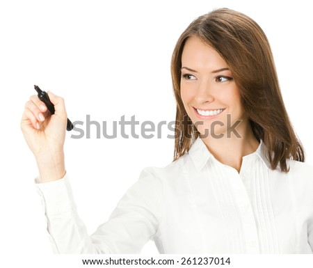 Happy smiling young businesswoman writing or drawing on screen with black marker, isolated against white background - stock photo