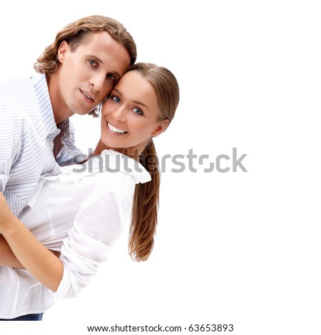 Happy smiling young couple isolated on white - stock photo