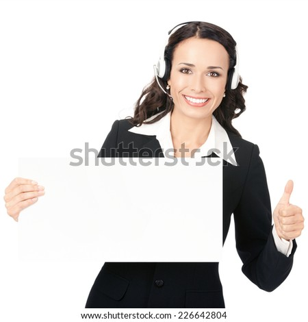 Happy smiling young customer support phone operator in headset showing blank signboard with thumbs up, isolated on white background