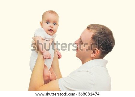Happy smiling young father playing having fun with baby  - stock photo
