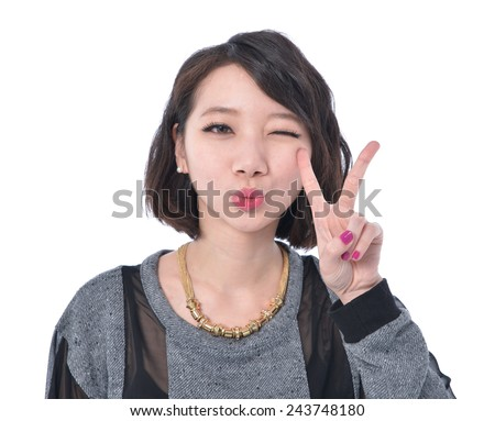 happy smiling young girl show victory sign - stock photo