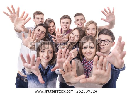 Happy smiling young group of friends. isolated over a white background. Hands up to camera.
